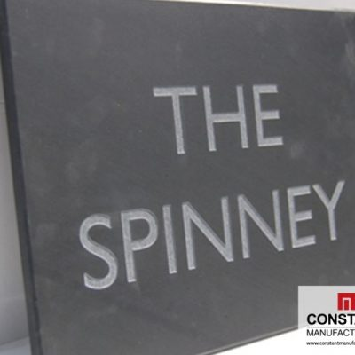 Engraved building name plaque on slate