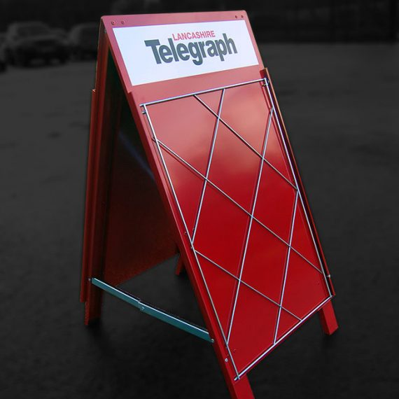 Assembled metal newspaper stand