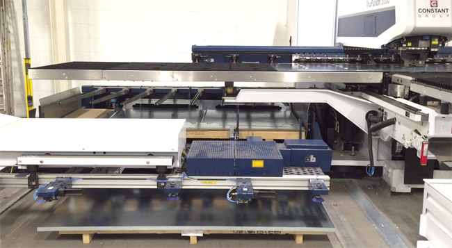 The TruPunch 3000 is about to finish punching and instructs the Sheetmaster Compact to prepare a new sheet of metal