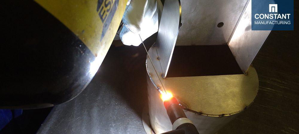 Tack welding the metal food funnel