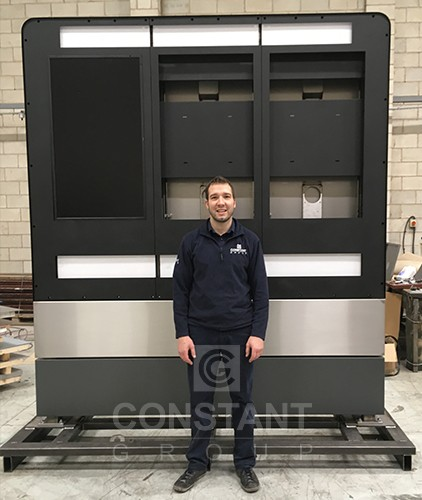CAD Design Manager, Johnny, in front of the part-completed display stand
