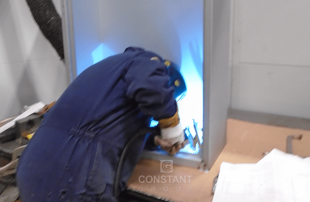 Welding a metal communications cabinet